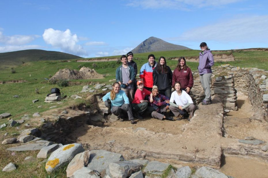 Students in excavated cottage site, Caraun Point, Achill Island