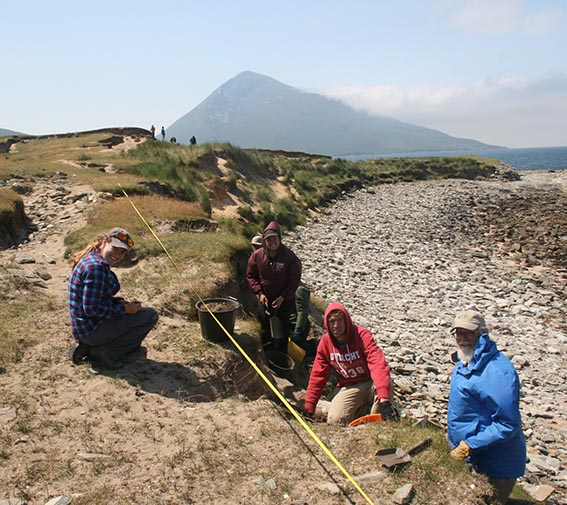 Archaeology students researching at Caraun Point, Achill Island
