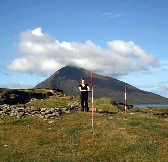 Archaeology student surveying at Caraun Point, Achill Island