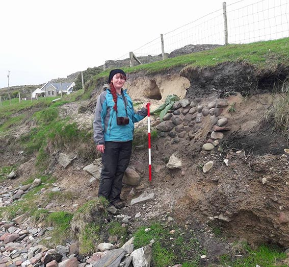 Archaeology student with ranging pole