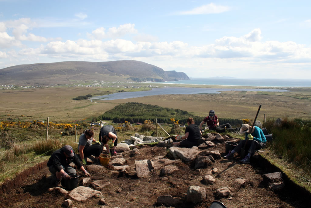 Students excavating at Cromlech Tumulus site, Slievemore