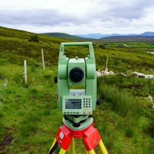 Surveying tool on tripod, in countryside